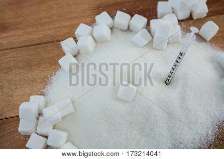 Close-up of syringe in sugar powder