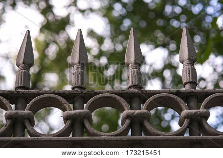 black metal fencing with a sharpen spear tip top.