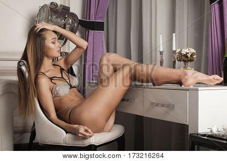 Beautiful Sensual Brunette Woman Posing In Elegant Lingerie. Lady With Long Healthy Hair. Slim, Fit