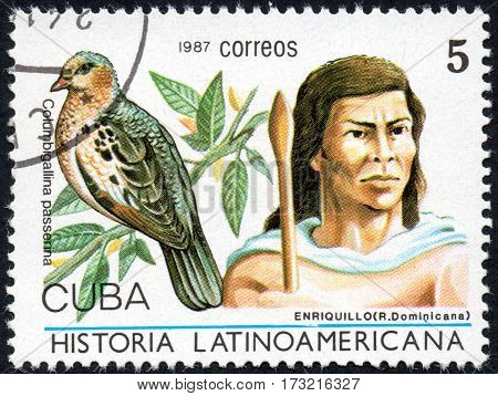 UKRAINE - CIRCA 2017: A stamp printed in Cuba shows Image of a chieftain Enriquillo Dominicana and bird Columbigallina passetina the series Latin American history circa 1987