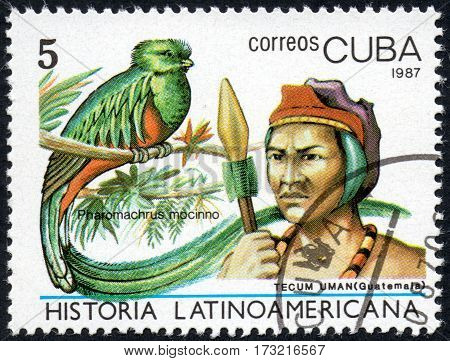 UKRAINE - CIRCA 2017: A stamp printed in Cuba shows Image of a chieftain Tecum Uman Guatemala and bird Pharomachrus mocinno the series Latin American history circa 1987