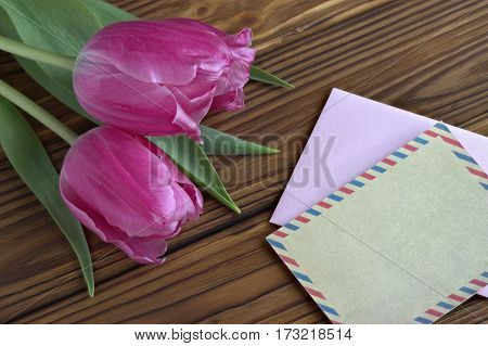 Beautiful Pink Tulips On Wooden Background With Envelop.copy Space. Valentines Day.