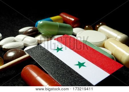 Syrian Flag With Lot Of Medical Pills Isolated On Black Background