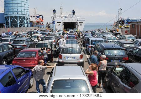 People Waiting Near Their Cars Boarding The Ferry
