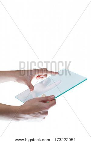Close-up of hands pretending to use digital tablet against white background
