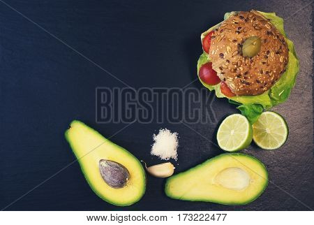 Sandwiches with avocado lettuce cheese on the kitchen blackboard
