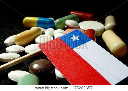 Chilean Flag With Lot Of Medical Pills Isolated On Black Background