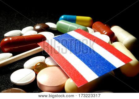 Thai Flag With Lot Of Medical Pills Isolated On Black Background