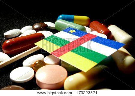 Central African Republic Flag With Lot Of Medical Pills Isolated On Black Background