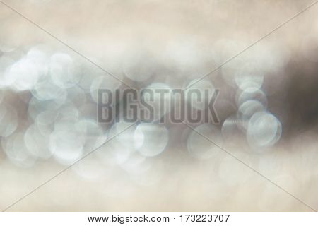 blurred abstract golden background with white bokeh