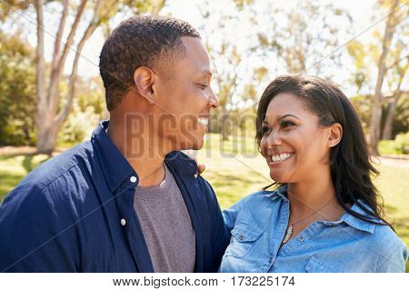 Outdoor Head And Shoulders Shot Of Couple In Park