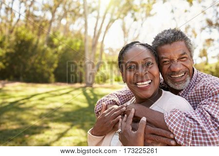 Outdoor Head And Shoulders Portrait Of Mature Couple In Park