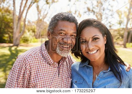 Portrait Of Father And Adult Daughter In Park Together