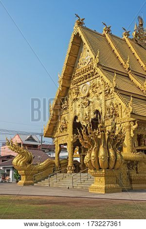 Wat Sripanton in Nan Thailand golden temple with dragons in front