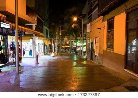 PUERTO DE LA CRUZ, TENERIFE, SPAIN - 12.02.2017: View of the night street in city Puerto de la Cruz in Tenerife Canary Islands Spain