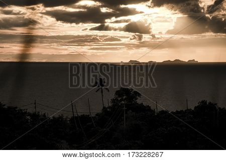 Panoramic sunset by the sea from island Koh Phangan with Ang Thong Marine Park in background Thailand