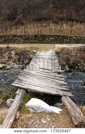 Old Wood Bridge Over Creek