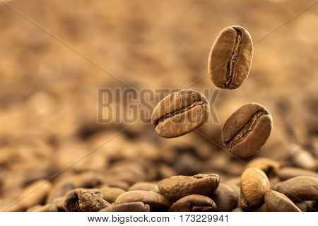 Flying fresh coffee beans as a background with copy space. Coffee beans falling down