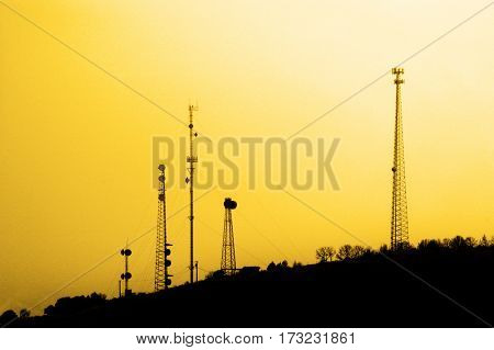 Several radio towers for transmission transmitting signals cell phone tv