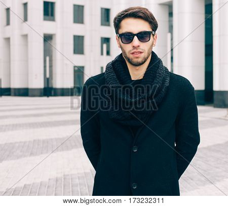 Portrait of fashionable young man in sunglasses in cool weather. Outdoor. Fashion and Style. Streetstyle.
