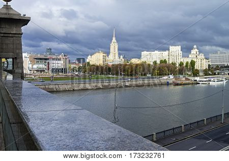 MOSCOW RUSSIA - JANUARY 21 2017: Moscow skyline. View of Square of Europe and hotel Ukraina from a pedestrian bridge across the Moscow River. October cloudy.