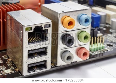 Ethernet port and ports for connection of audio devices on the motherboard