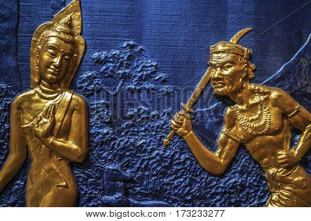 Golden decorations on the blue wall on a Buddhist temple, Georgetown, Penang, Malaysia