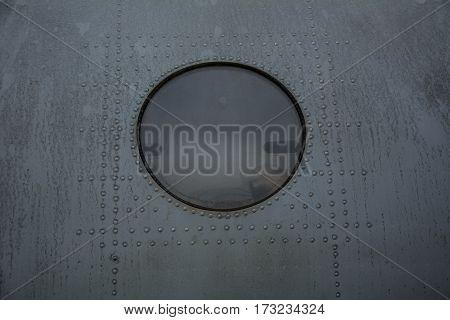 Grunge old airplane porthole close up background