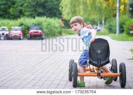 Little Preschool Boy Driving Big Toy Sports Car And Having Fun,