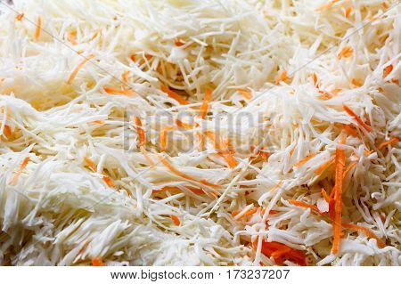 Vegetable background with cabbage and carrots. Cabbage and carrots are shredded.