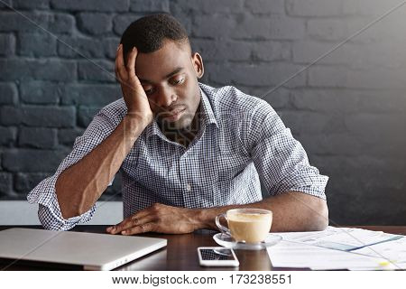 Frustrated Tired Young African-american Employee Touching His Head, Feeling Absolutely Exhausted Bec