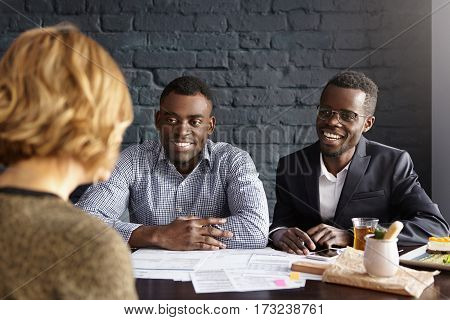 Happy African-american Ceo And Hr Director Smiling Cheerfully During Job Interview With Attractive C