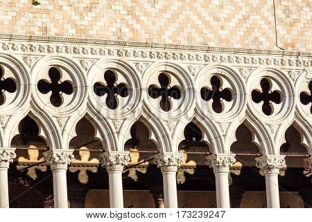 front view closeup of white Doge's Palace white tracery facade in Venice, Italy, Europe .