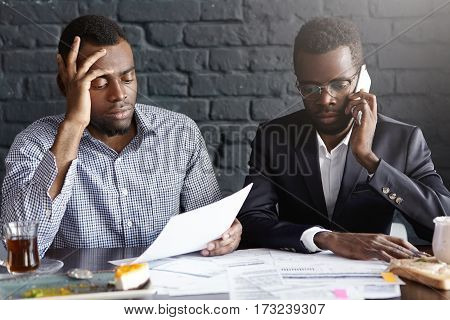 Unsuccessful Negotiations. Depressed Upset African-american Businessman Talking On Cell Phone, Negot