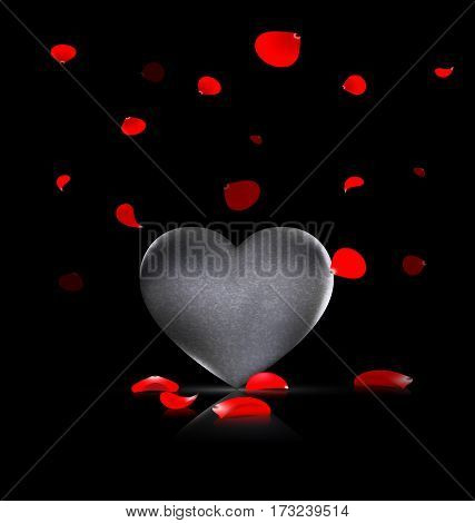 black background and the large stone heart with falling red petals