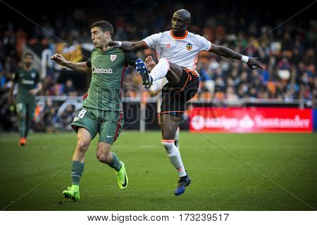 VALENCIA, SPAIN - FEBRUARY 19: (R) Mangala, (L) Iturraspe during La Liga soccer match between Valencia CF and CD Athletic Club Bilbao at Mestalla Stadium on February 19, 2017 in Valencia, Spain