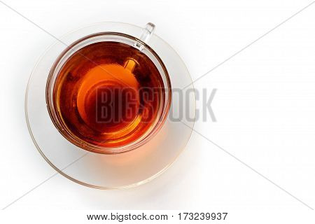 cup of saturated tea isolated on white