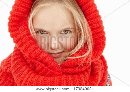 Winter Portrait Of Pretty Charming Little Girl With Blonde Hair And Fair Skin Posing Outdoors Wearin