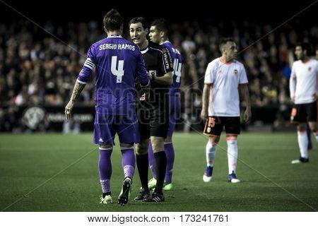 VALENCIA, SPAIN - FEBRUARY 22: (L) Ramos and referee during La Liga soccer match between Valencia CF and Real Madrid at Mestalla Stadium on February 22, 2017 in Valencia, Spain