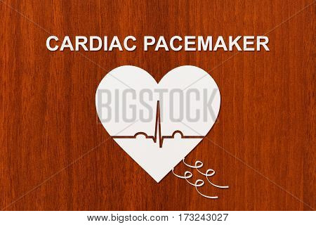 Heart shape with echocardiogram and CARDIAC PACEMAKER text. Medical cardiology concept