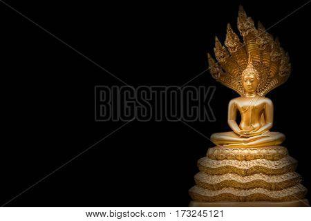 Golden Nak Prok Buddha isolated black background