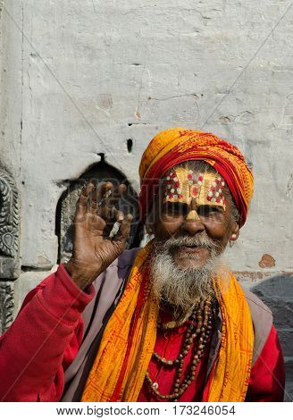 Kathmandu, Nepal - February 19, 2014: unidentified Sadhu Holy man with traditional painted face, blessing in Pashupatinath Temple. February 19, 2014, Kathmandu, Nepal.