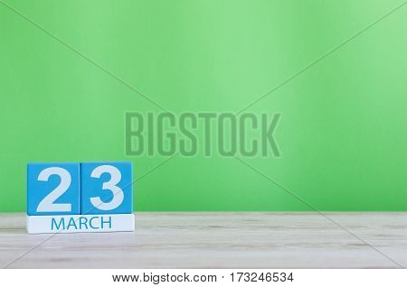 March 23rd. Image of march 23 wooden color calendar on white background. Spring day, empty space for text.