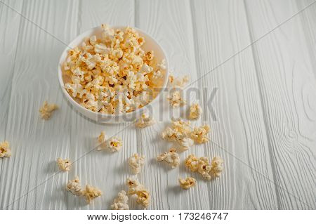 popcorn - on a white wooden background
