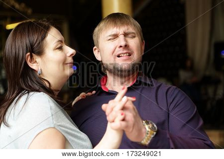 Couple dancing a slow dance in club