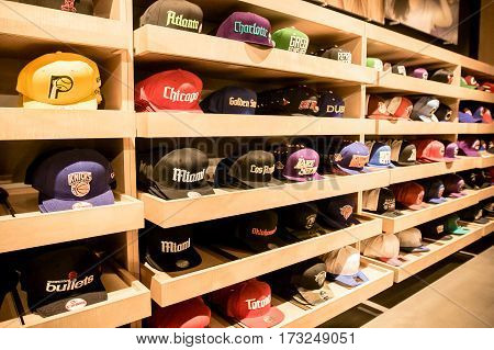 New York, February 21, 2017: A wide variety of baseball caps with NBA team logos fill the shelves of the NBA store in Manhattan.