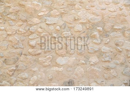 old beige stone wall pattern background abstract grunge texture of pebble rock - use for architectural material concepts