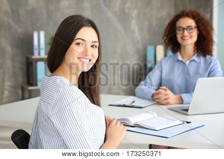 Job interview concept. HR manager interviewing woman