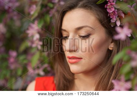 beautiful young woman near the blossoming spring tree.