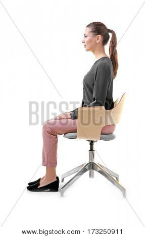 Incorrect posture concept. Young woman sitting on chair against white background